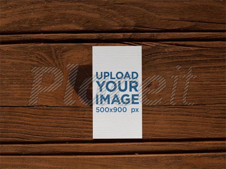 Vertical Business Card Mockup Lying On A Wooden Surface A15019Foreground Image