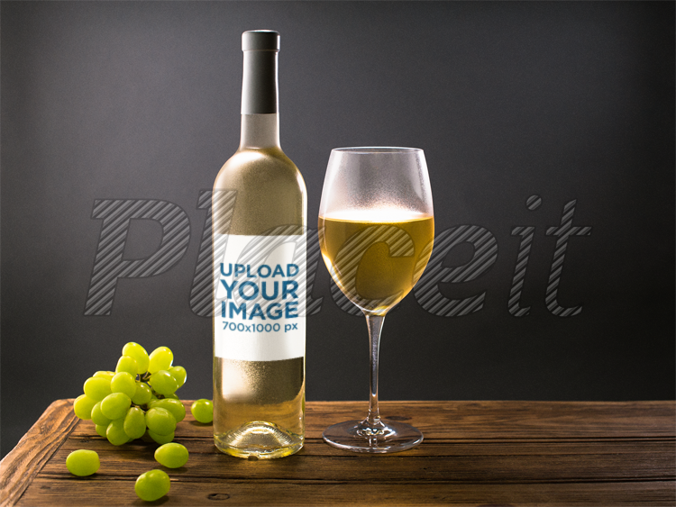 placeit template of a white wine bottle and a glass with grapes