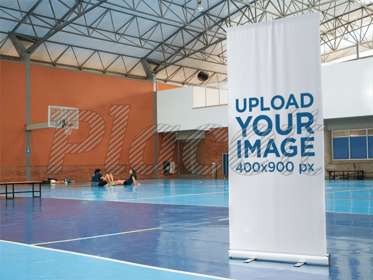 Placeit - Vertical Banner Mockup at an Indoor Basketball Court