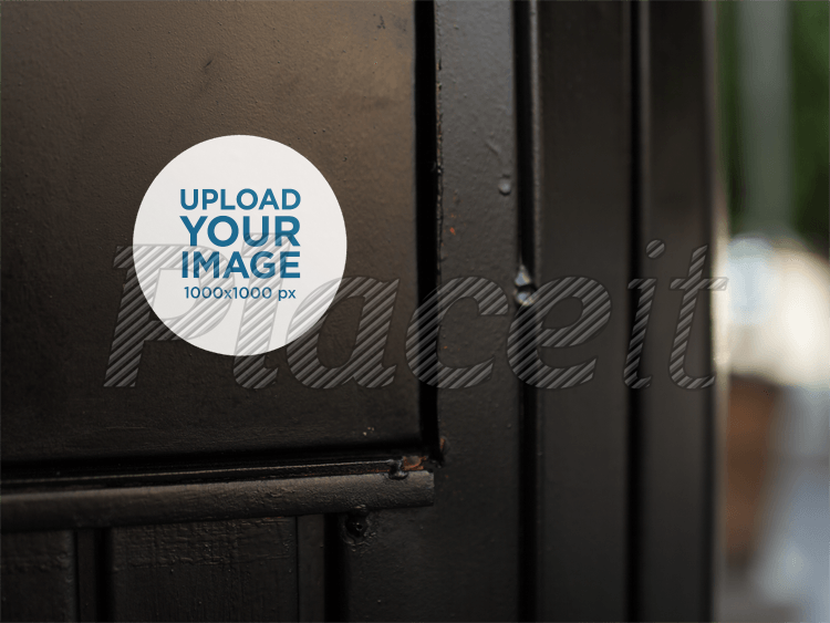 placeit round sticker on a black door template