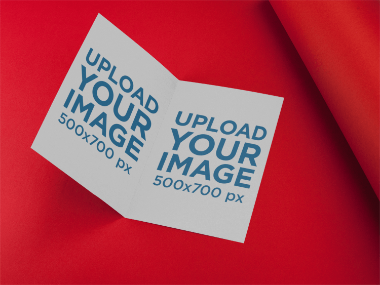 placeit bifold brochure template lying open in a red room