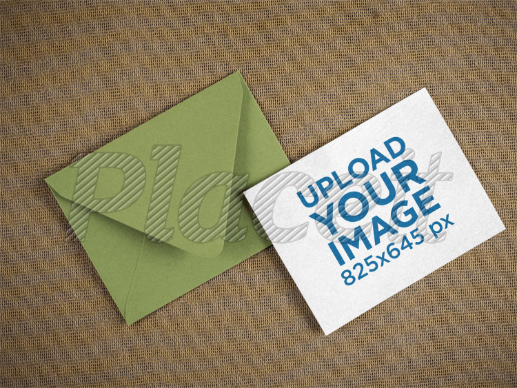 placeit template of a green envelope with an invitation besides it
