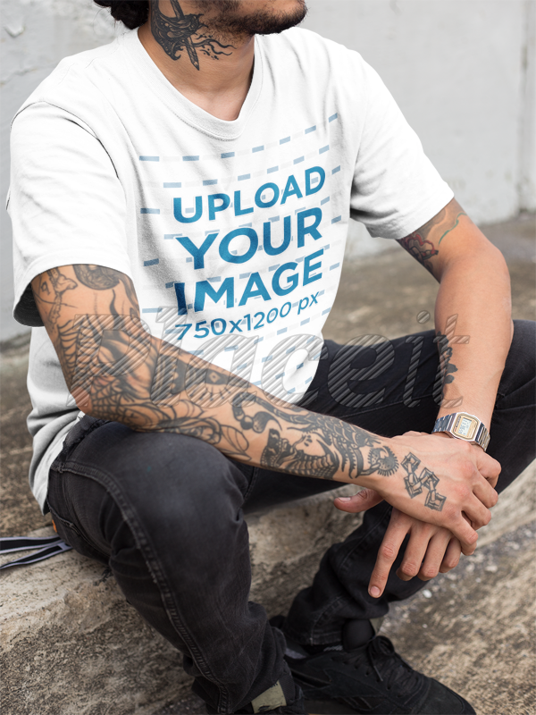 caac0c055 Closeup of a Hispanic Tattooed Man Wearing a T-Shirt Mockup While Sitting  Down