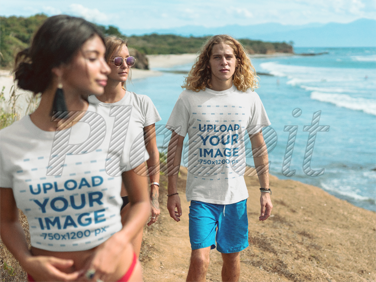 placeit group of friends walking by the beach wearing t shirts mockup