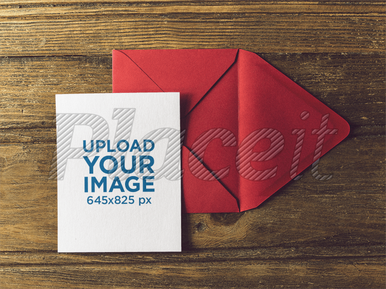 placeit invitation template on a red envelope over a wooden table