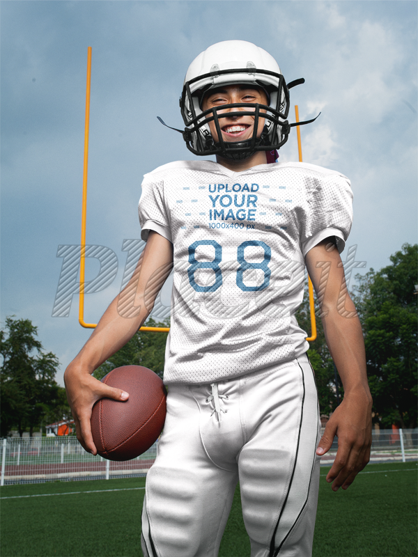 0c61b17b4 Placeit - Custom Football Jerseys - Happy Dude with the Ball at the ...