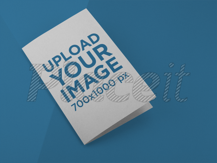 placeit bifold brochure template lying on a surface with soft colors