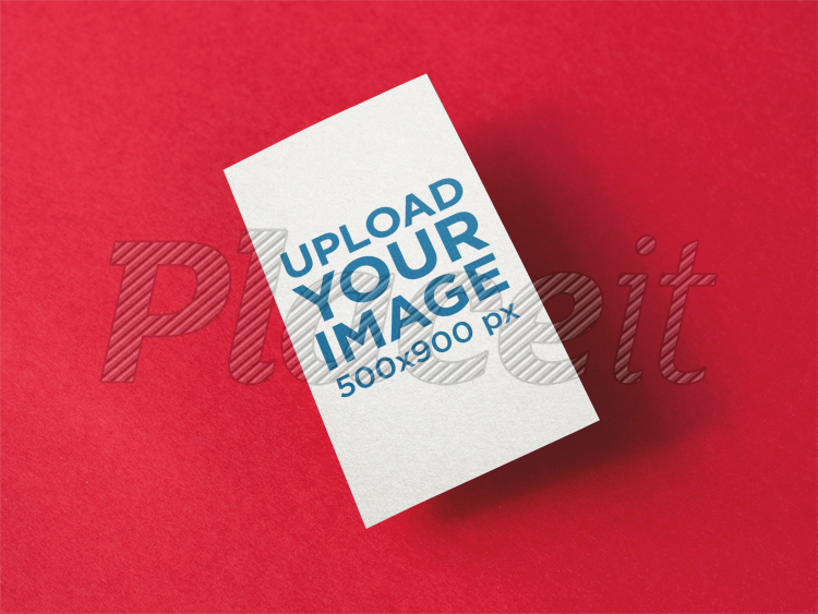 Placeit vertical business card mockup floating over a red surface vertical business card mockup floating over a red surface a14991foreground image colourmoves
