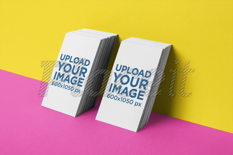 Placeit business card mockup of two vertically stacked sets business card mockup of two vertically stacked sets leaning against a wall 21954foreground image colourmoves