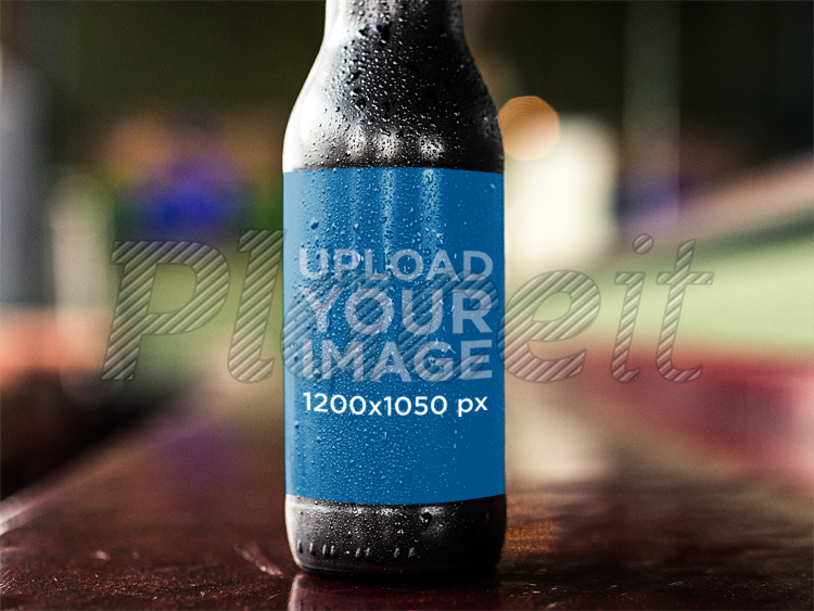 placeit dark beer bottle label template while on a counter bar
