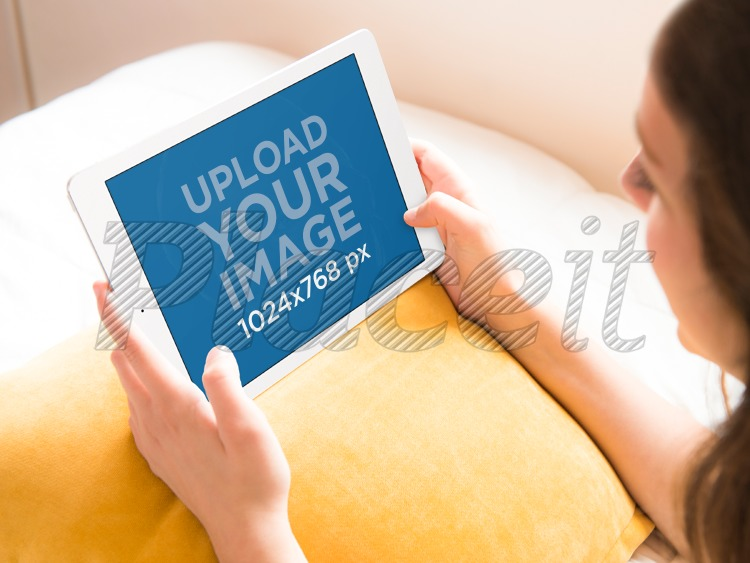 placeit young woman uses ipad on bed tablet mock up template