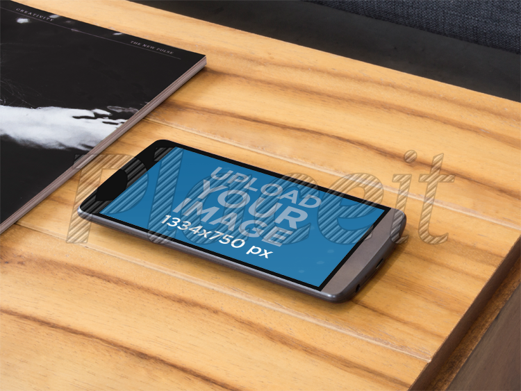 Placeit Android Mockup Of Black LG G Laying Over Coffee Table - Android coffee table