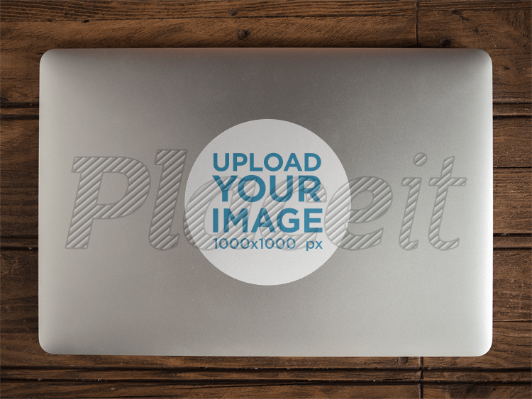 Sticker on top of a macbook mockup a14308foreground image