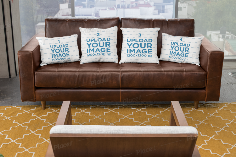 Mockup of Four Pillows on a Leather Sofa 23548